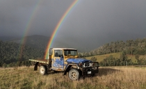 An old Toyota at the end of a rainbow  by Donovan Wilson