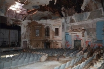 An old vaudeville theater that was at the end of my street growing up It failed showing foreign films porn Rocky Horror second run movies and then was left empty Hurricane Sandy took off the roof and opened it up to the elements There were failed plans to
