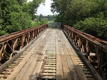 An old World War II Bailey Bridge now sits abandoned on a closed road in a small town in Kentucky full album in comments