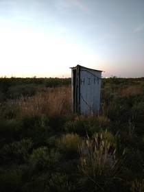 An outhouse hours from civilization in West Texas
