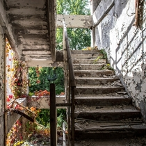 An overgrown staircase in the abandoned Jupiter Factory on the outskirts of Pripyat Aside from the nearby Chernobyl Nuclear Power Plant this industrial complex producing audio-electrical equipment was one of the largest local employers