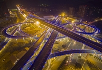 An overpass lighted in blue is seen during a hazy day in Jinan Shandong province China