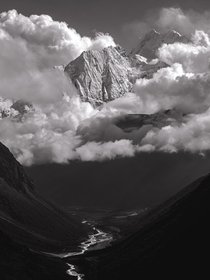 An unnamed peak through the clouds Manaslu Nepal   x