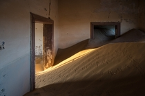 Animal tracks criss-cross sand dunes that have crept into the deserted houses of the ghost town Kolmanskop in Namibia  photo by MrBlackSun