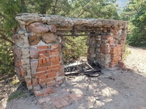 Another abandoned fireplace on a mountain From the ruins of the Crags Hotel in El Dorado State Park near Denver Colorado Last September