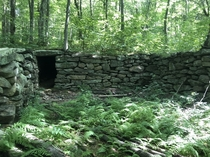 Another abandoned house foundation Sutton MA USA There is nothing through the doorway it ends with a giant stone