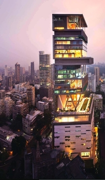 Antilia - Mukesh Ambanis Single Family Home - Mumbai India -  story -  metres high  over  sq ft - Multi-level Gardens -Stunning water features -  helipads - -seat theatre -  elevators - Grand Ballroom - Swimming pools   level Parking garage for  cars   Fu