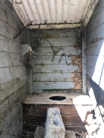 Anyone need the bathroom I dont know why I was so excited about seeing an outhouse its the first one Ive ever come across Toilet roll was still in the holder More info in comments