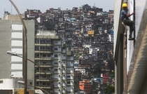 Apartment buildings stand next to houses in the Rocinha favela community Rio de Janeiro Mario Tama
