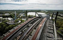 Apex of roller coaster at abandoned amusement park