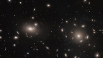 Apparent gravitational anomalies in the Coma Cluster are considered visual evidence of dark matter  Hubble