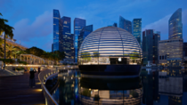 Apple Marina Bay Sands s the first Apple Store to sit directly on the water appearing as a sphere floating on the iridescent Marina Bay Singapore
