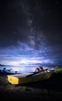Approaching storms under the Milky Way in Cedar Key FL