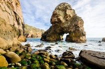 Arched sea stack and rocky beach at Cabo da Roca Portugal
