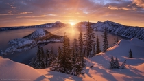 Arclight - A golden winter sunrise at Crater Lake Oregon by Alex Noriega