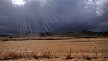 Arid Central California Farmland Under a Stormy Sky