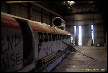 Arotrain i-HV a jet-powered monorail hovercraft sits abandoned in a hangar at Chevilly France in  It was destroyed by fire two years later Serge Lepaire