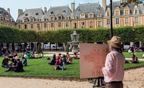 Artist at work in the Place des Vosges Paris