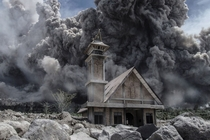 Ash cloud from Mount Sinaburg looms over an abandoned church