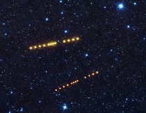 Asteroids Klotho and Lina orbiting about the Mars-Jupiter asteroid belt captured by NEOWISE