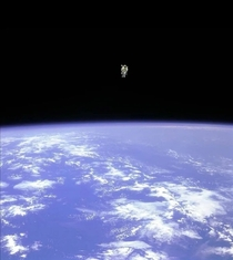 Astronaut Bruce McCandless II as he floated away untethered from the space shuttle with only the manned maneuvering unit keeping him alive  and he was the first person to do so
