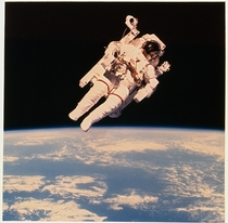 Astronaut Bruce McCandless II floats a few meters away from Space Shuttle Challenger during the historic first use of a nitrogen-propelled manned maneuvering unit in  NASA