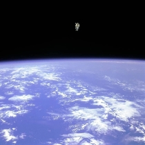 Astronaut Bruce McCandless II floats untethered away from the safety of the space shuttle with nothing but his Manned Maneuvering Unit keeping him alive The first person in history to do so