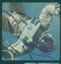 Astronaut Edward H White performs an EVA over the Gulf of Mexico
