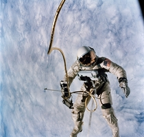 Astronaut Edward H White pilot for the Gemini IV spaceflight floats in space during the first spacewalk by an American