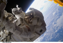 Astronaut Steve Bowen STS- mission specialist participates in the missions third scheduled spacewalk as construction and maintenance continue on the International Space Station - November