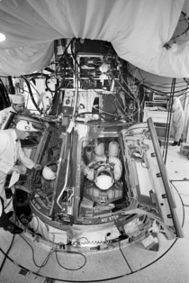 Astronauts David Scott and Neil Armstrong inserted into the Gemini- spacecraft prior to liftoff  March