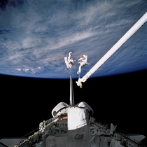 Astronauts Lee and Meade perform an EVA in Discoverys payload bay