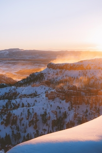 At sunrise wind blew snow up from the hoodoos to resemble mist The entire canyon looked like it was on fire Bryce Canyon UT