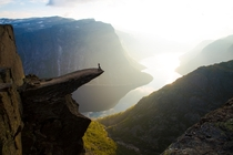 At the edge of Trolltunga  meters above Lake Ringedalsvatnet Norway  Photo by Christopher Baldry