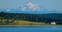 At the feet of a sleeping dragon - Whidbey Island WA looking to Mt Baker  miles away and   up