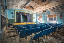 Auditorium of abandoned school in Detroit has definitely seen better days