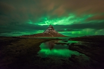 Aurora among the clouds before the arrival of a snowstorm on the Kirkjufell