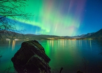 Aurora and stars above Reed in Nordfjord Norway