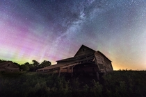 Aurora over an abandoned Nebraska farmstead