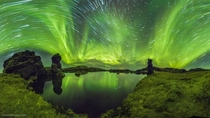 Auroras and Star Trails over Iceland The featured  panorama is the digital fusion of four wide-angle cameras each simultaneously taking  shots over  minutes Credit Vincent Brady