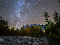 Autumn Leaves Star Trails and the Milky Way over the Castle Crags in Northern California