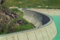 Awesome tilt-shift photograph of the Lac de Moiry Dam in the Swiss Alps