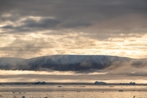 Awesome view of the iconic mountains and ice in the far north of Thule Region Qaanaaq Greenland