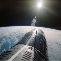 Backdropped over the Pacific Ocean the nose of the Gemini spacecraft is seen as photographed by astronaut Eugene A Cernan pilot of the Gemini-A spaceflight June