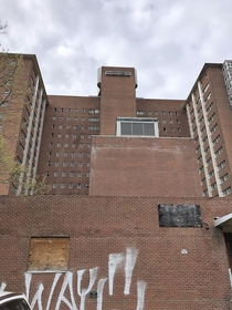 Backside Of Abandoned Psychiatric Hospital in Rochester NY As A Thunderstorm Rolls In
