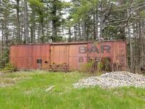 Bangor and Aroostook Railroad  refrigerator boxcar in the Maine woods