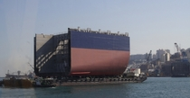 Barge transports Superblock section of a cargo ship under construction Busan Korea