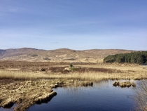 Barren windswept landscape surrounding Glenveagh in Donegal Ireland