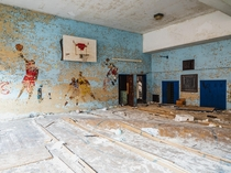 Basketball players on the wall of an abandoned Elementary School OC