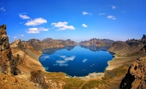 Beakdu Mountain is an active volcano on the border between North Korea and China At  m  ft It is also the highest mountain on the Korean Peninsula and in northeastern China There is a large crater lake called Heaven Lakein the caldera atop the mountain wr